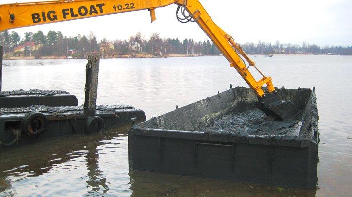 Barge stockage CDO INNOV, pelle big float - RDS France, spécialiste du matériel TP